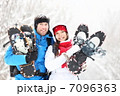 Winter couple outdoors on snowshoes