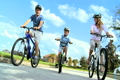 Caucasian Family Group Cycling Outdoors