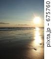 砂浜 日の出 海岸の写真 675760