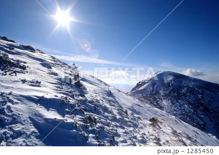 冬の八ヶ岳・天狗岳と太陽 1285450