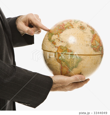Businessman holding globe.の写真素材 [3344049] - PIXTA