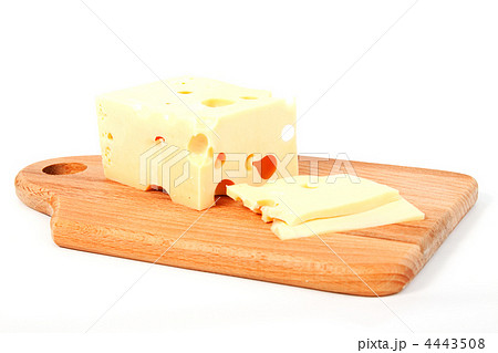 Cheese on wooden kitchen boardの写真素材 [4443508] - PIXTA