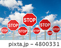 many stop signs on White, fluffy clouds in blue sky collage 4800331