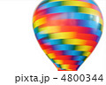 multicolored hot-air balloon toy whirling isolated on white back 4800344