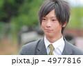 制服姿の男子高校生 4977816