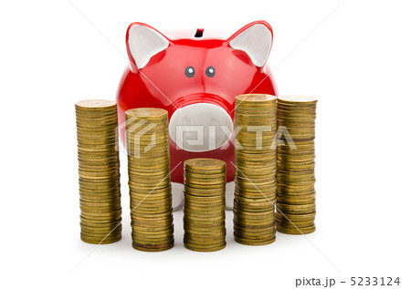 Piggy bank and coins isolated on whiteの写真素材 [5233124] - PIXTA