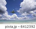 旅客機 白い雲 海の写真 6412392