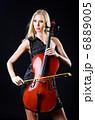 Woman playing cello on white 6889005