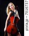 Woman playing cello on white 7016737
