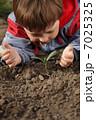 sprout in children hand 7025325
