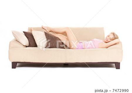 sleeping woman on sofaの写真素材 [7472990] - PIXTA