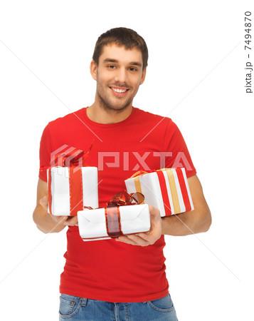man holding many gift boxesの写真素材 [7494870] - PIXTA