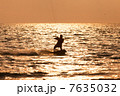 Kite surfer sailing in the sea 7635032