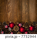 Wood background with Christmas ornaments 7732944