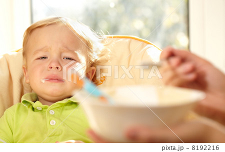 Kid is very disappointmented about porridge. 8192216