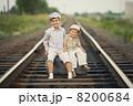 boys with suitcase on railways 8200684