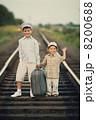 boys with suitcase on railways 8200688