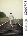 boy with suitcase on railroad 8200703