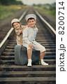 boys with suitcase on railways 8200714