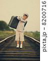 boy with suitcase on railroad 8200716