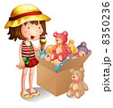 A young girl beside a box of toys 8350236
