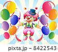 A clown with a colorful costume surrounded by balloons 8422543