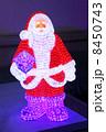 Beautiful multi-colored illuminated Christmas Santa Claus with l 8450743