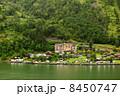 GEIRANGER - JUNE 26: Grande Fjord Hotel in small coastal village 8450747