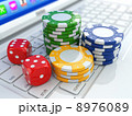 Online casino. Dices and chips on laptop. 8976089