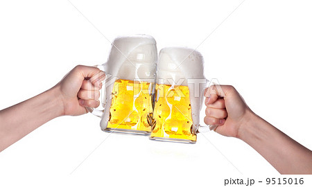 two hands holding beers making a toastの写真素材 [9515016] - PIXTA