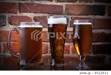 Glass of light beer on a dark pub.の写真素材 [9522611] - PIXTA