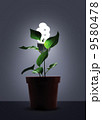 Sprout in flower pot with white light bulb 9580478