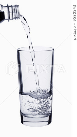 Water pouring on a glass isolated on whiteの写真素材 [9580543] - PIXTA