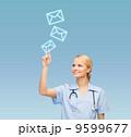 smiling doctor or nurse pointing to something 9599677