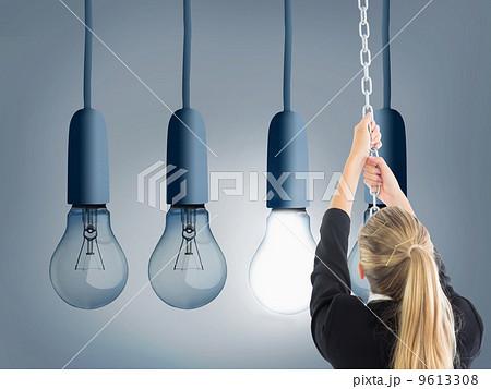 Composite image of businesswoman pulling a chainの写真素材 [9613308] - PIXTA
