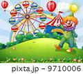 A hilltop with a clown and an amusement park 9710006