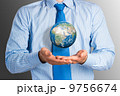 businessman holds up a planet Earth 9756674