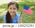 Young girl holding the American flag at park 10025291