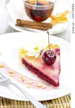 piece of cherry pie on a table in a restaurant 10079666