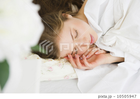 Woman sleeping in bed 10505947