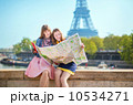 Two girls looking for direction in Paris 10534271