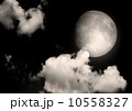 The moon in the night sky in clouds 10558327