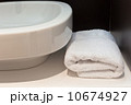 Bathroom sink with white towel 10674927