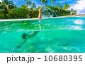 Woman swimming underwater 10680395