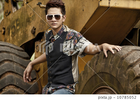 Asian man in printed polo and vest 10785052