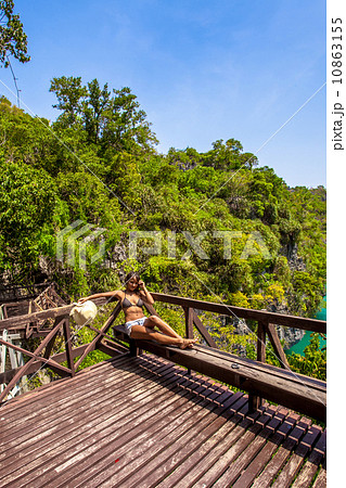 View wooden platform near the blue lagoon in marine national park and girl looking on lake 10863155