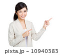 Woman presenting with two finger point up 10940383