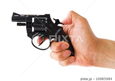 モデルガンの撃鉄を起こす手 10965984