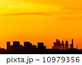 Orange sky over city 10979356