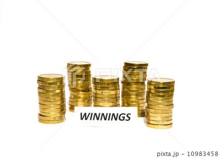 Winnings sign at coin pilesの写真素材 [10983458] - PIXTA